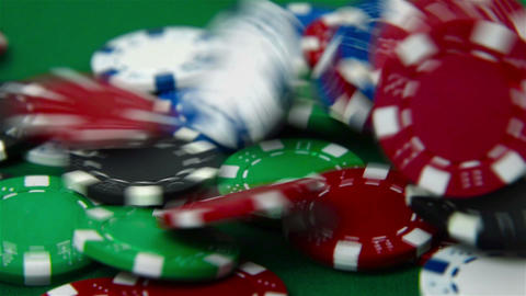Falling colored poker chips Footage