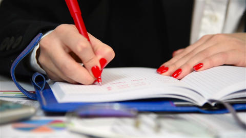 Businesswoman writing in diary Footage