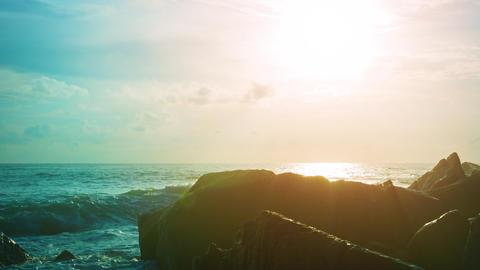 Bright Sunshine over a Rocky Tropical Coastline Footage