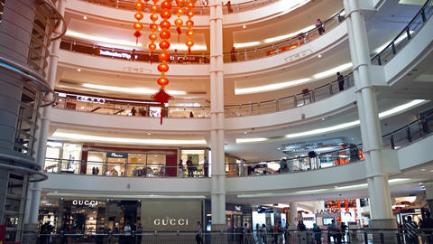 Giant Paper Lanterns Hang from the Ceiling as Shoppers Stroll through Suria KLCC Live Action
