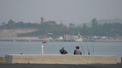 fisher man on breakwater Footage