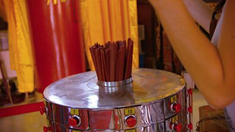 Buddhist Worshiper Uses Prayer Sticks inside Thean Hou Temple in Kuala Lumpur. M Footage