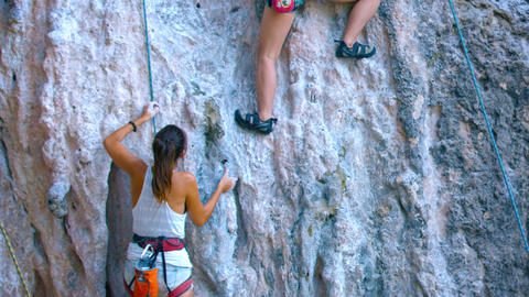 Inexperienced Tourists Look for Handholds while Climbing the Seacliff at Railay Footage