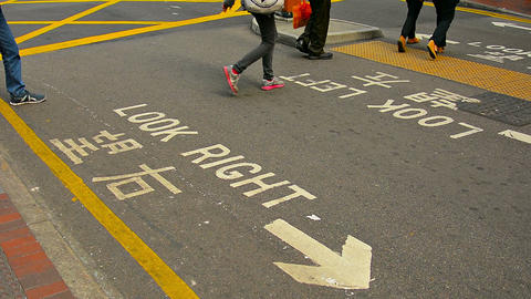 Legs and Feet of Pedestrians Crossing a Downtown City Street in Hong Kong. China Live Action