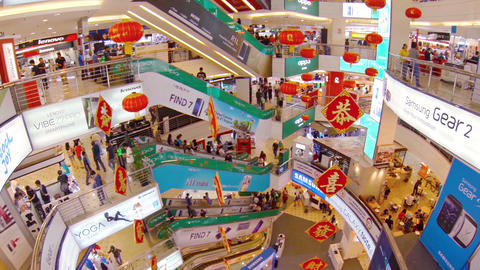 Interior of a Massive. Eight Story Shopping Mall Complex in Kuala Lumpur. Malays Live Action