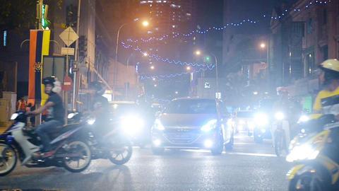 Glaring Headlights of Typical Night Time Traffic in Downtown Kuala Lumpur Malays Footage