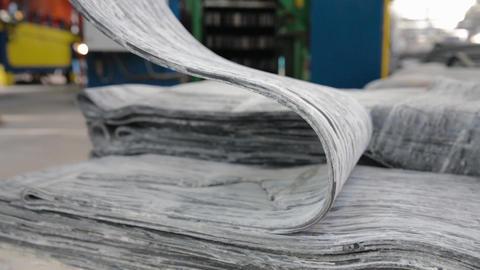 Rubber tape on a large tire factory close-up Acción en vivo