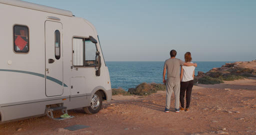 Travelers relaxing camping and enjoying traveling in recreational vehicle Live Action