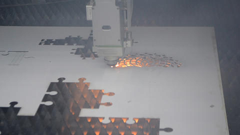 Fiber laser machines for metal cutting close-up. A laser beam cuts Live Action