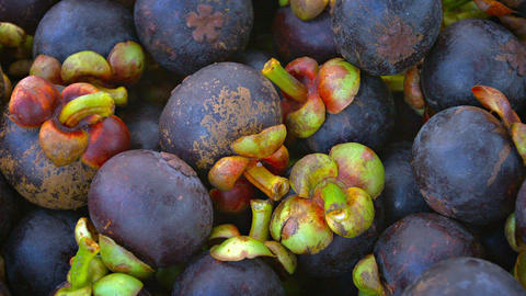 Highly Nutritious and Flavorful Mangosteen Fruit at a Public Market Footage