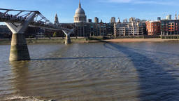 Millennium bridge and St Pauls Cathedral River Thames London UK Footage