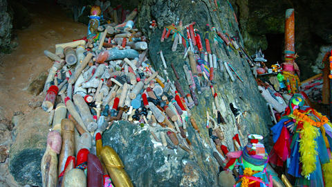 Heaps of Painted Wooden Penises Offered at a Buddhist Shrine Footage