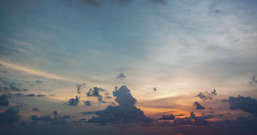 Sky with soft. puffy clouds. as the sun slowly descends towards the horizon Footage