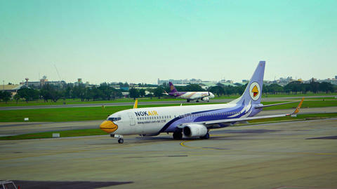 Nok Air Airliner Taxis towards Runway at Don Mueang International Airport in Ban Footage