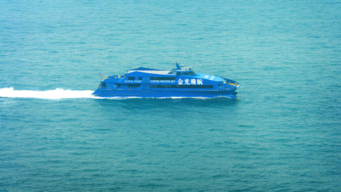Ultra modern and high tech Cotai Water Jet Ferry. cruising at high speed through Footage