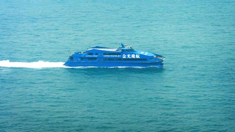 Ultra modern and high tech Cotai Water Jet Ferry. cruising at high speed through Footage