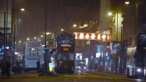 Public transportation at night in Hong Kong. including buses. electric cable car Footage