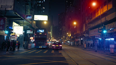 Typical night time traffic on an urban street in downtown Hong Kong Footage