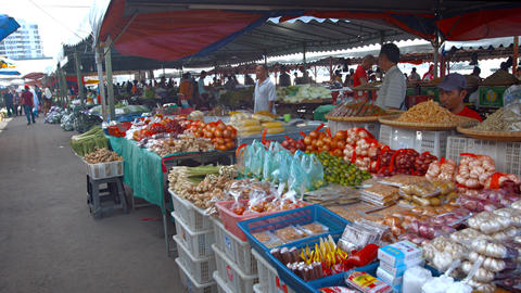 Locals shopping for fresh produce at an outdoor. public market in Borneo. Malays Footage