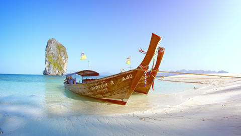 Beautifully handcrafted longtail boats. tied at Railay Beach in Thailand. with a Footage