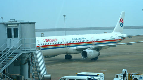 China Eastern Airline passenger plane. rolling up to a docking sleeve Footage