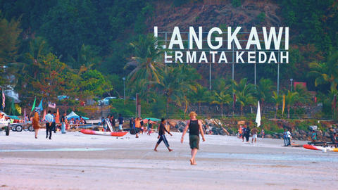Tourists enjoying a day at the beach in Langkawi. Malaysia Live Action