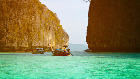 Boats Cruise Slowly around the Limestone Formations in Thailand Footage