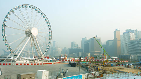 Big ferris wheel and other amusement rides at a park in downtown Hong Kong Footage