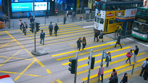 Pedestrians crossing a busy urban intersection at a safety crosswalk Footage