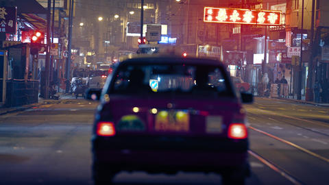 Downtown. Hong Kong street at night. with taxis and buses Footage