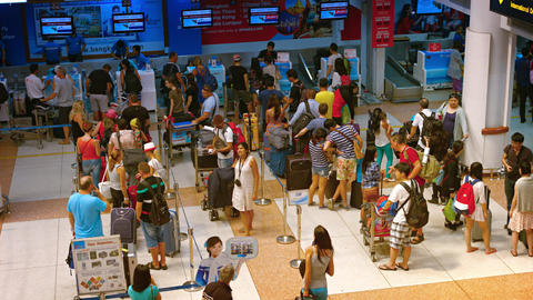 Passengers waiting in line at the Air Asia departure check-in counter Footage