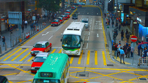 urban vehicle and pedestrian traffic at a downtown. Hong Kong Footage