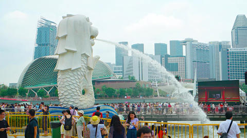 Merlion Fountain sprays water into Marina Bay in Singapore Footage