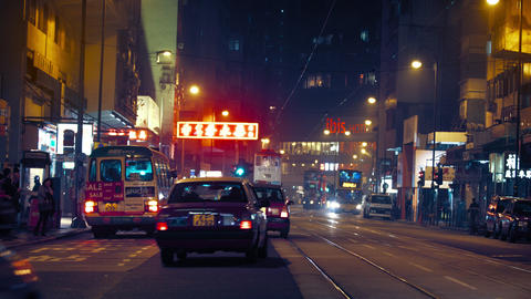 Night time traffic on a typical urban street in downtown Hong Kong Footage
