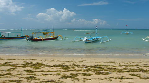 Motorized. outrigger canoes. anchored off a beach in Sanur. Bali. Indonesia Footage