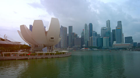 Lotus shaped architecture of the ArtScience Museum and Singapore's skyline Live Action