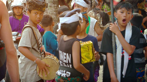 Children playing traditional. Balinese percussion instruments on the street Footage