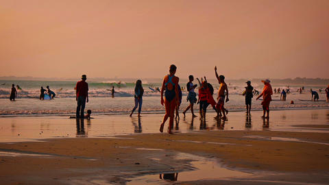 Beachgoers participating in all kinds of recreational activities. Kuta. Bali Footage