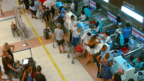 Passengers registration on Bangkok airways airline desks in departing hall Footage