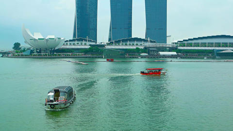 Boat traffic in the harbor in front of Marina Bay Sands Resort Hotel Footage