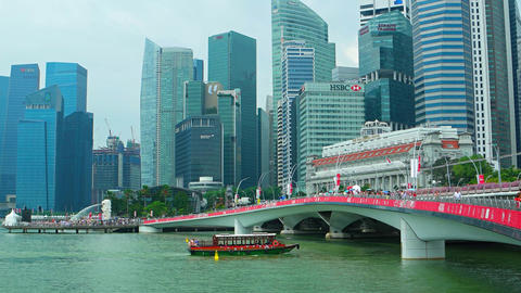 New Jubilee Bridge and Singapore river cruise boat with Downtown urban skyline Live Action