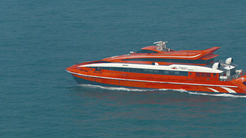 Turbojet ferry fast moves forward in blue sea waters. cutting video across Footage