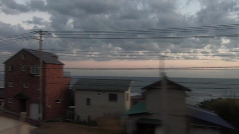 Railway train window. A view of the evening sea ライブ動画