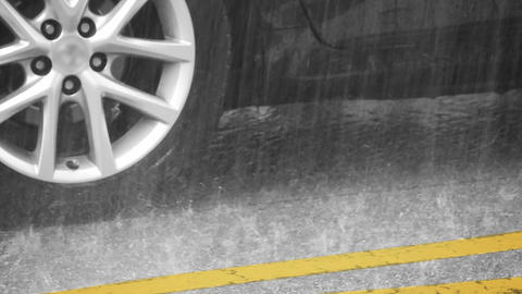 Closeup of Heavy Rain on a City Street Footage