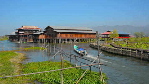 Handmade Tour Boat Navigates Canals on Inle Lake in Myanmar Footage