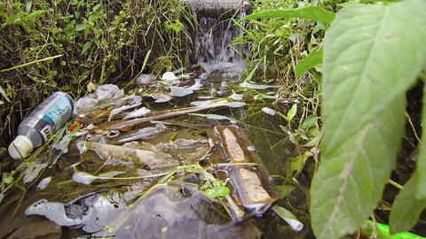 Rubbish and Litter Floating in an Irrigation Canal Footage