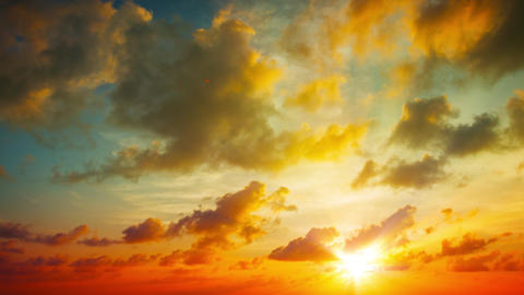 Puffy Clouds Drifting in Timelapse in a Sunset Sky. UltraHD video Footage