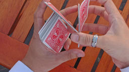 Closeup Conjurer Hands Shuffle Cards for Trick above Table Footage