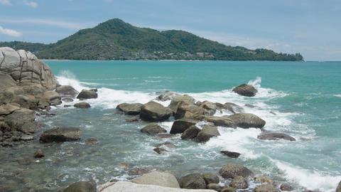 Gentle Waves Splash over a Rocky Tropical Beach Live Action