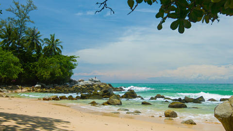 Tourists Enjoying an Exotic Tropical Beach with Boulders and Trees Footage